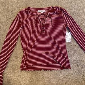 red and white striped long sleeve shirt